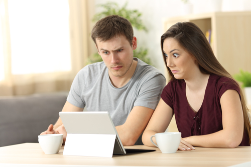 couple surprised tablet
